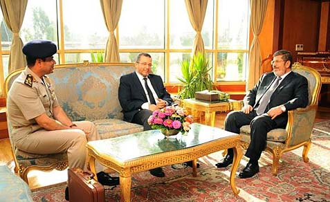 A photo released by the Egyptian President's office, July 1, 2013: Egyptian President Mohammed Morsi, right, meets with Prime Minister Hesham Kandil, center, and Egyptian Minister of Defense, Lt. Gen. Abdel-Fattah el-Sissi, left, in Cairo.