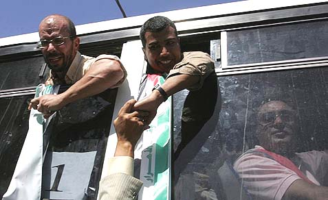 Palestinians who were freed from Israeli jails as part of a prisoners exchange deal for captured Israeli soldier Gilad Shalit arrive at the Rafah crossing border in the Gaza Strip, October 18, 2011.