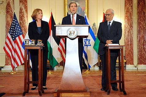U.S. Secretary of State John Kerry, Israeli Justice Minister Tzipi Livni, and Palestinian Chief Negotiator Saeb Erekat address reporters at the U.S. Department of State in Washington, D.C., on July 30, 2013.