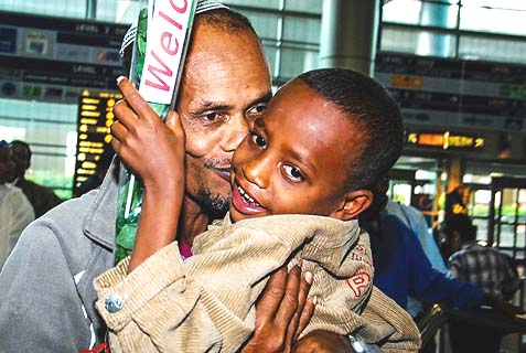 Ethiopian father and son upon making Aliyah, Aug. 28, 2013.