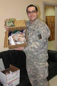 A soldier receiving his package from KosherTroops
