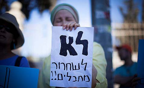 "A relative of terror victims' sign says: ""No to Prisoner release."""