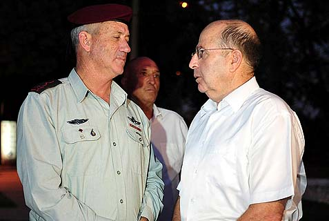 "Israeli Defense Moshe ""Bogie"" Ya'alon (R) and IDF CHief of Staff Benny Gantz spoke at a memorial service for IDF Givati Brigade soldiers Tuesday night. Both men had no doubt about Israel's ability to defend against events north of the border, should the U.S. make good on its promise to attack the Syrian regime."