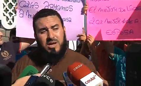 Malik Ibn Benaisa, surrounded by supporters, speaks at a press conference in Ceuta.