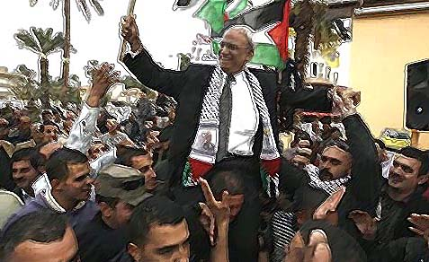 Palestinian chief negotiator Saeb Erekat being carried in a rally last winter.