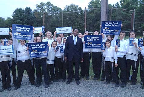 Brooklyn DA candidate Ken Thompson in the company of his biggest fans, yeshiva boys in the Catskills bungalows. He accuses the incumbent, Charles Hynes, of using proxies to smear his name in the Jewish community.