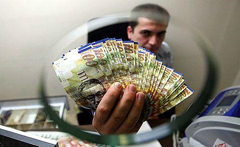 Close-up of Hundred shekels bills in Jerusalem