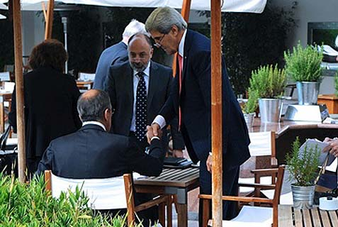 Secretary Kerry shaking hands with Russian Foreign Minister Lavrov (sitting), after the two have finalized an agreement on Syria in Geneva, Switzerland, September 14, 2013.