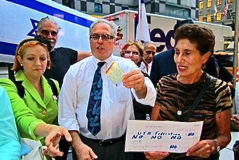 Pro-Israel New Yorkers symbolically burned their checks to the NY UJA-Federation on Sept 12