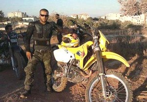 Islam al-Tubasi, 19, seen with his dirt bike, was killed this morning.