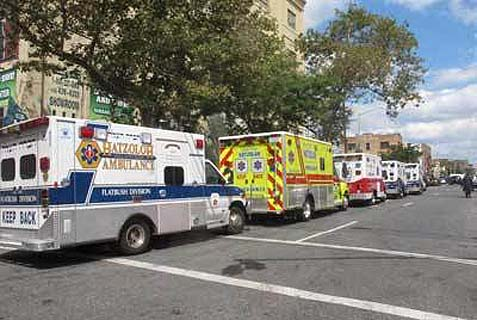 A line of ambulances. Dozens of ambulances and other emergency vehicles accompanied the hearse to JFK airport. Zakheim was buried on Har Hamenuchot in Jerusalem.