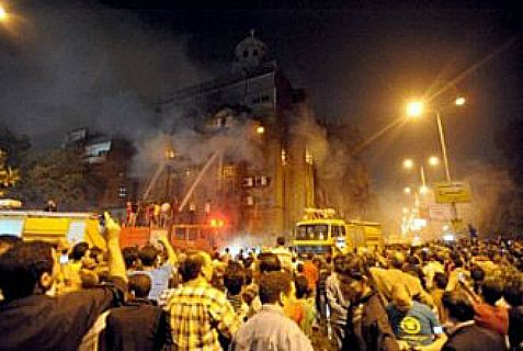 Coptic church on fire in Egypt, where the miliitary regime has declared war on Islamic terrorism