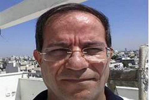 Belgian-Iranian spy Mansouri, with Tel Aviv in the background, was arrested for spying for the Revolutionary Guards.