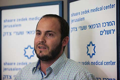 The father of the 9-year old Jewish girl who was shot by a Palestinian in Psagot speaking to the press at Shaare Tzedek hospital in Jerusalem.