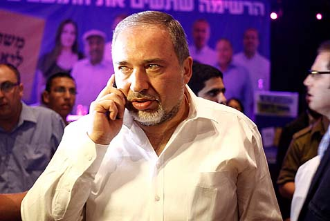 MK Avigdor Lieberman getting the news of his candidate's defeat in the Jerusalem mayoral election Tuesday night. Things have been going badly for this Israeli political boss, who's facing a court decision on his future.