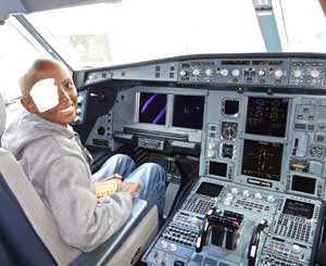 Befekadu in the cockpit of the Delta flight after landing