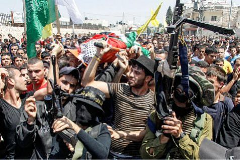 PA terrorists escort PA mourners carrying the body of terrorist shot by the IDF during an arrest operation.
