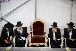 Rav Ovadia's chair remains empty next to his sons in the mourning tent in Jerusalem.