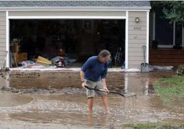 A resident digging out from the flood.