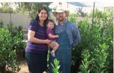 Elly and Matt Bycer, with their daughter, Nava, stand in their backyard esrog farm in Scottsdale, Arizona – which contains more than 400 esrog trees. The project is under the supervision of Rabbi Zvi Holland, former dean of the Phoenix Community Kollel and current kashrut administrator with the Star-K Kosher Certification agency.