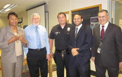 (L-R) Captain Evangeline Nathan, Rabbi Alan Kalinsky, Senior Lead Officer Ballasteros, Rabbi Adir Posy, and Jay Greenstein.