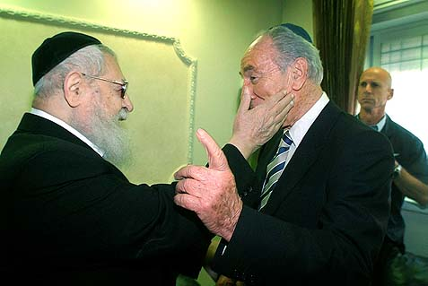 Rav Ovadia jovially slapping Israel's current president, Shimon Peres, June, 2007