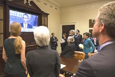 Members of the Cabinet are watching in the White House Roosevelt Room, as President Barack Obama makes a televised statement on the government shutdown, Sept. 30.
