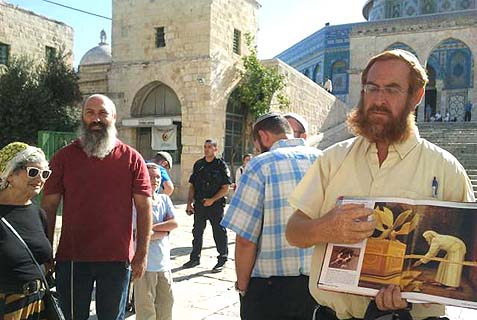 Tour guide Yehuda Glick (right) leading a group on Temple Mount.