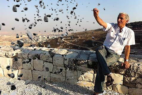 Danny Seidmann with rocks.