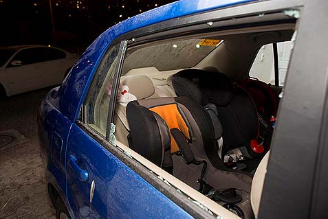 The broken rear window of the car where 2-year-old Avigail Tzur sustained injuries from stones thrown by Arabs, November 28.