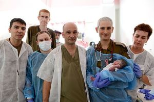 "The first baby to be delivered by the IDF in its search and rescue mission in the Philippines is named ""Israel."""