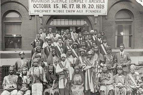 Attendees of the 1928 Moorish Science Temple Conclave in Chicago. Noble Drew Ali is in the front row center.