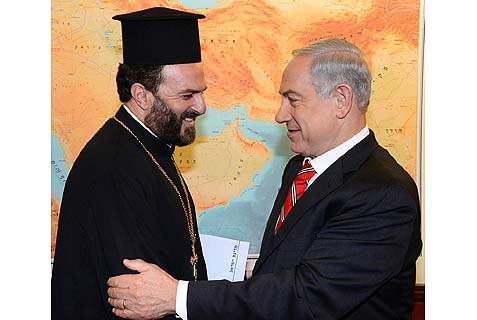 Prime Minister Benjamin Netanyahu (R) meeting with Greek Orthodox priest Father Gabriel Nadaf in Jerusalem.