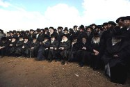 Rebbes and their flock at a rally outside a military prison south of Haifa, in solidarity with two Yeshiva students who were imprisoned for refusing to report to the IDF recruitment offices earlier this month. The notion that only non-Haredi Jews will get killed defending the Jewish State is repugnant. The idea that Israeli Haredi rabbis will go to the diaspora to say loshon hora against Israeli Jews is grotesque.