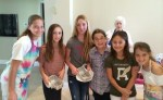 Kayla Wolfson (left) with volunteer bakers for Sharsheret.