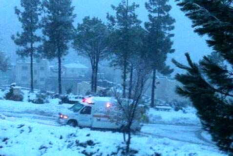 MDA ambulance on snow-covered road during the massive snowstorm that struck Israel.