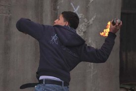 Arab youth throwing a firebomb at Jews. Jewish settlers are subject to daily threats of violence, with the most recent victims being two baby girls in two separate incidents.