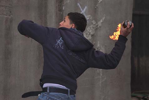 Arab youth throwing a firebomb at Jews. Jewish settlers are subjected to daily threats of violence, with the most recent victims being two baby girls in two separate incidents.