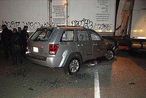 A bullet ridden Jeep Grand Cherokee in a carport (illustration image).