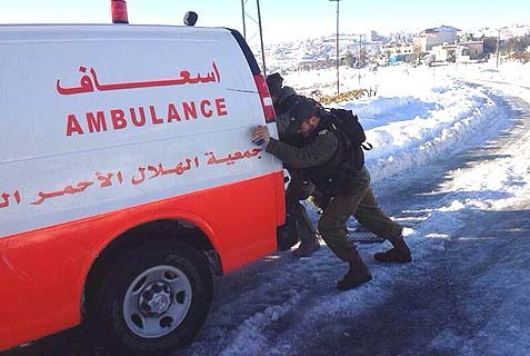 soldiers push arab ambulance