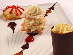 Dessert sampler of tiramisu, cheesecake and napoleon
