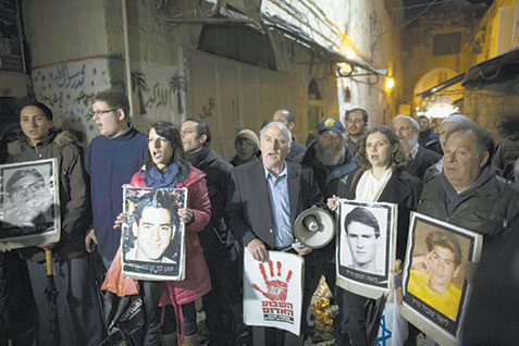 Activists and bereaved families demonstrate in Jerusalem Monday night against the release of 26 Palestinian terrorists.