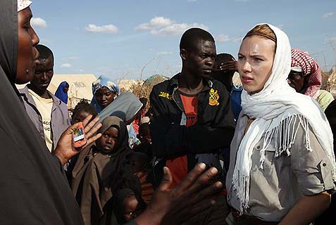 Oxfam Ambassador Scarlett Johansson at a camp in northern Kenya during a visit to east Africa. The left has been harassing her because she supports a Jewish factory that employs Palestinians. Why do they hate so much?