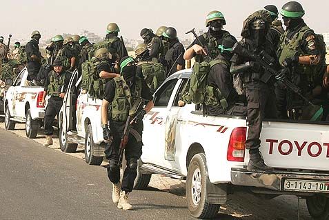 Masked terrorists from the Hamas army, the Ezzedine al-Qassam Brigades, riding through Rafah in the southern Gaza Strip. Egypt is now targeting them and their government for a process of elimination.