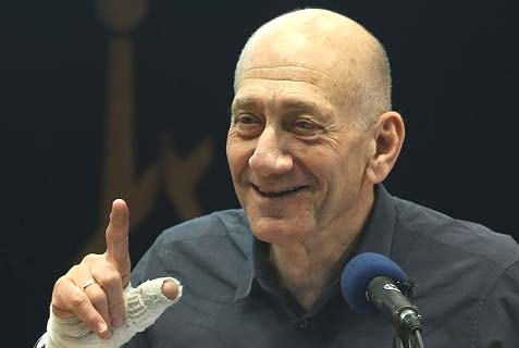 Olmert can keep smiling so long as he can stay out of jail.