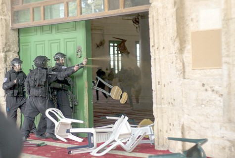 Arab rioters hurl objects at security personnel from inside the Al Aqsa mosque on the Temple Mount.