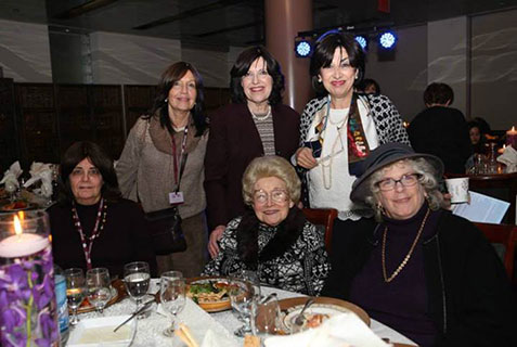Standing, left to right: Mrs. Rochel Goldman, Shlucha to Johannesburg, South Africa; Mrs. Rivka Kotlarsky and Mrs. Molly Resnick, co-directors of the Guest of Shluchos program. Sitting, left to right: Rebbetzin Shula Kazan, Shlucha to Cleveland, OH, and Mrs. Naomi Mauer, co-publisher of The Jewish Press.