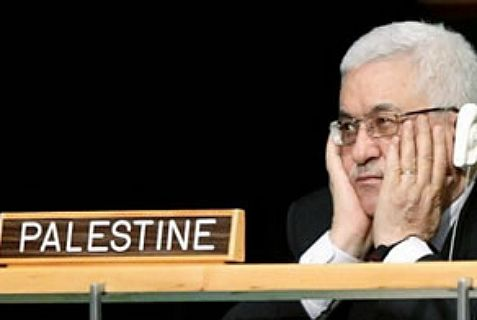 "Abbas sits behind ""Palestine"" sign at the United Nations."