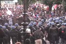 """Police charge a crowd of rioters at the January 26 """"Day of Wrath"""" protests."""