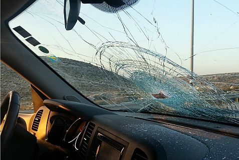 Drivers and passengers miraculously escaped injury in a massive Arab rock attack on cars.